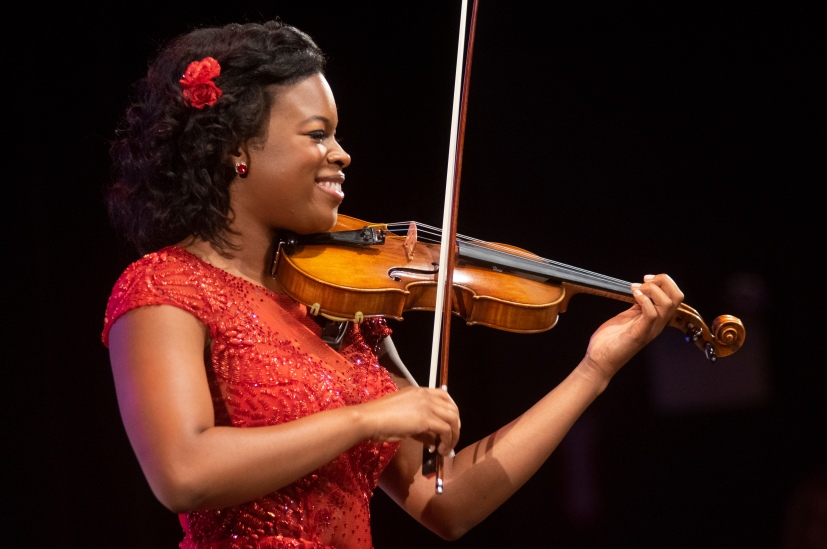 Carolyn Brady performs on her violin in the talent portion of the competition.